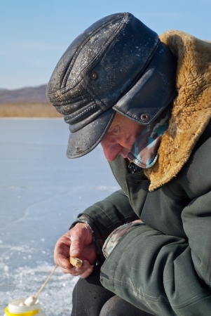handline fishing: An old man on winter fishing.