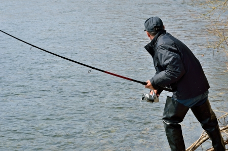 A man with spinning rod on fishing. Stock Photo
