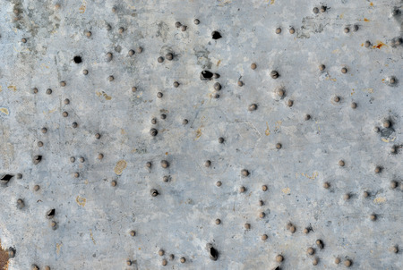A close up of the surface of metal after shot with shotgun. photo
