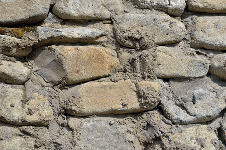 walling: A close up of the surface of stone wall. Stock Photo