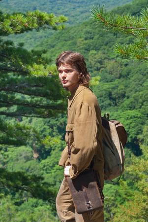 taiga: A young traveler in mountain taiga. Stock Photo