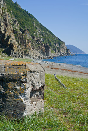 fortifying: A close up of the very old pillbox on seacoast.
