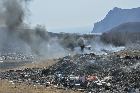 A landscape on scrap-heap in smoke.