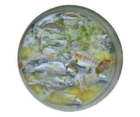 soup kettle: A fresh fish-soup in pot. Isolated on white.