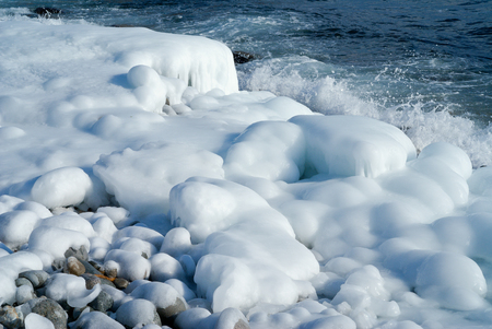 seawater: Winter on sea: stones with ice, seawater and surf.