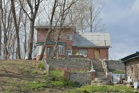 bathhouse: The country-cottage with vegetable-garden and bathhouse. Stock Photo