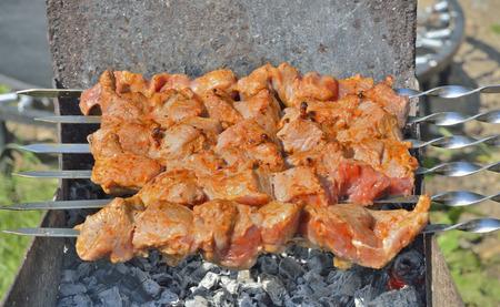 shashlik: A close up of the cooking shashlik on skewers. Stock Photo