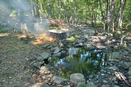 The medicinal bath at mineral spring with radon water in forest.