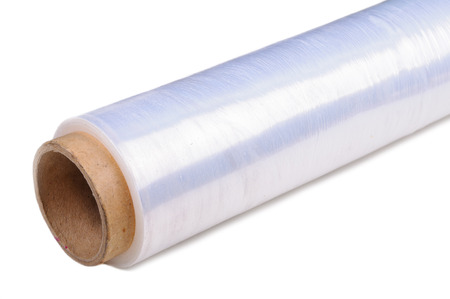 polythene film: Roll of wrapping plastic stretch film  Close-up with selective focus and Shallow Depth of Field  Isolated on white background   Stock Photo