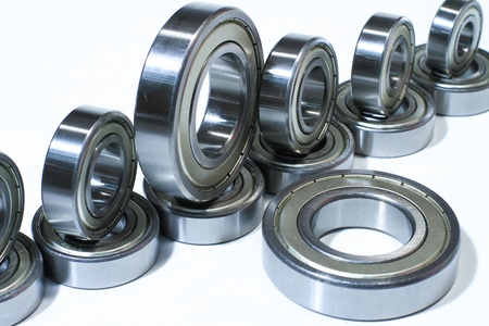 Many bearings of different sizes together  White background  photo
