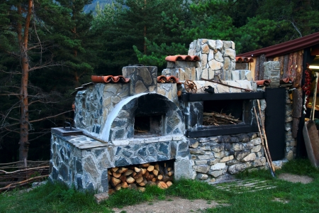 BBQ oven made ​​of stone in the courtyard of the house photo