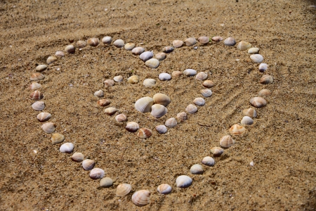 heart shape stone at beach photo