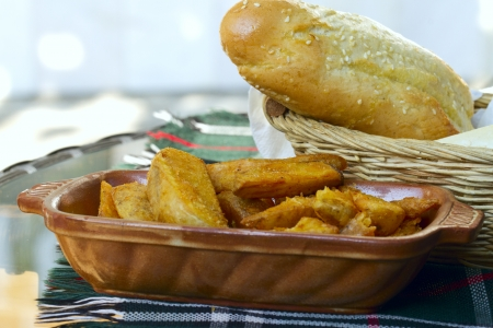Very tasty rural fried potatoes with bread photo