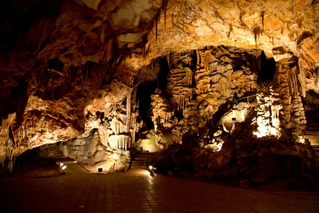 Beautiful cave with many stalagmites and stalactites inside