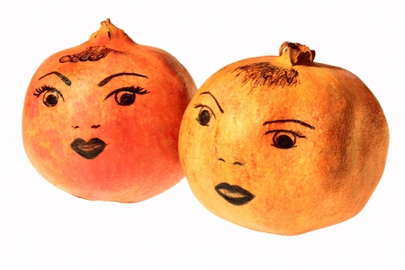 l nutrient: Two red ripe pomegranate with painted emotions  Stock Photo