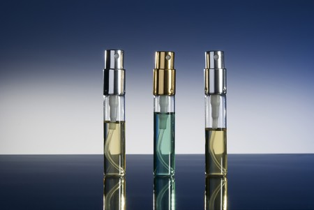 bottles with perfume isolated on gradient background Stock Photo