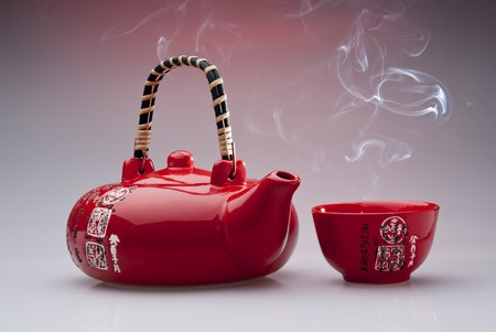 Chinese teapot with steaming cup   Stock Photo