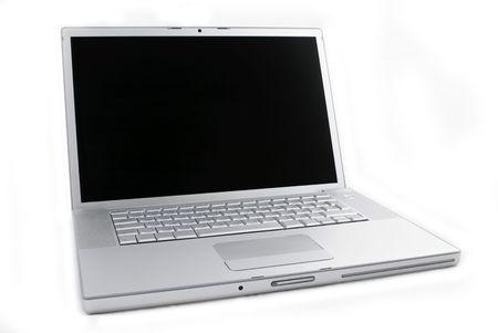 Silver portable computer. 34 view.