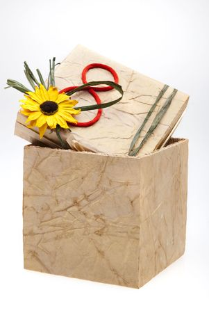 Gift box with number 8 and flower on cover, isolated on white background Stock Photo - 4233158