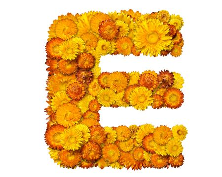 clippng: Letters from alphabet from yellow and orange flowers. Isolated on white background. With clipping path Stock Photo