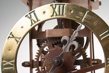 Antique looking clock dial showing time about twelve photo