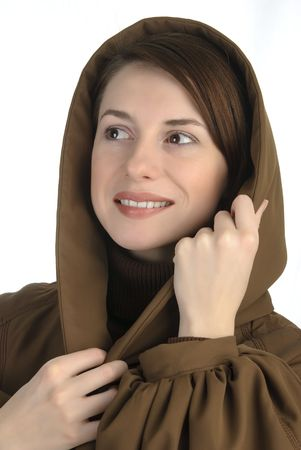 Cheerful young woman holding her hood Stock Photo - 6255303