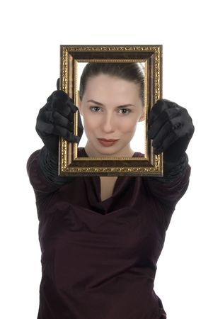 Young woman looking through picture frame photo
