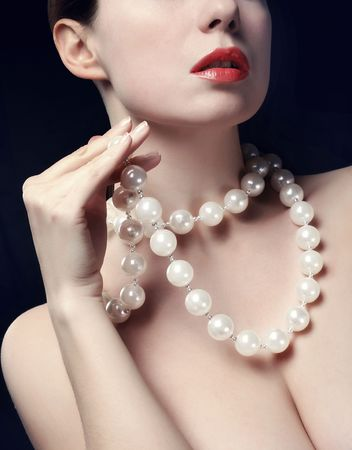 Topless young woman with pearls necklace