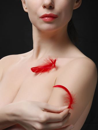 Young topless woman holding a plume Stock Photo