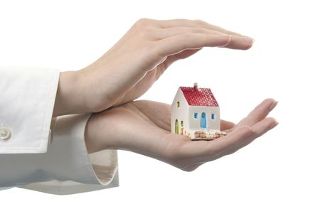 Womens hands with a little house Stock Photo