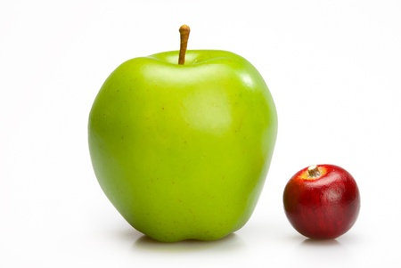 contrast: Big and small apples. Two ripe apples, red and green isolated on white background