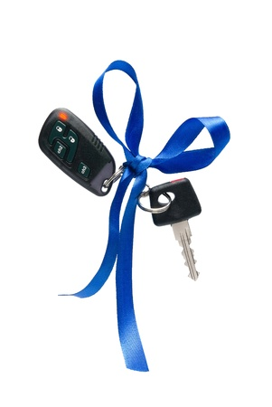 starter: Car ignition key with security system, isolated on white Stock Photo