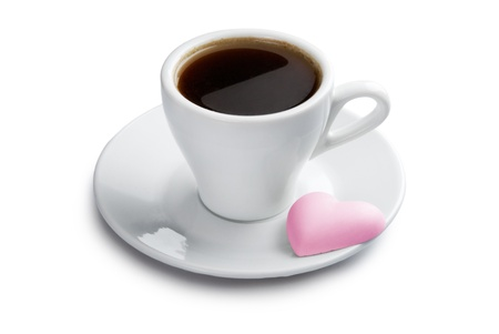 Cup of coffee with pink heart shape cookie. Isolated with clipping path on white background photo