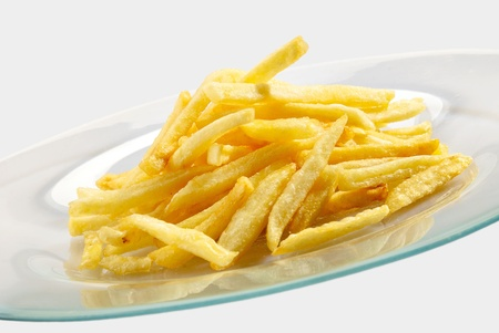 Fried potatoes on the plate over white background Stock Photo - 8765677