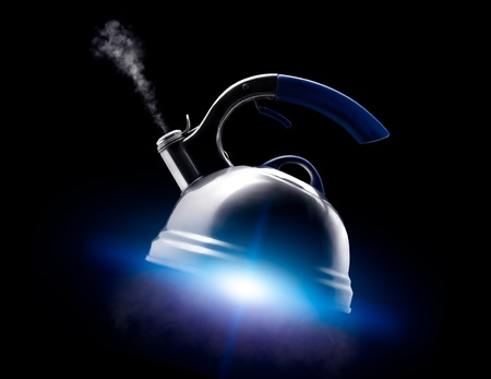 Tea kettle with boiling water on black background. Blue glow like from the spaceships engine under the kettle. Stock Photo