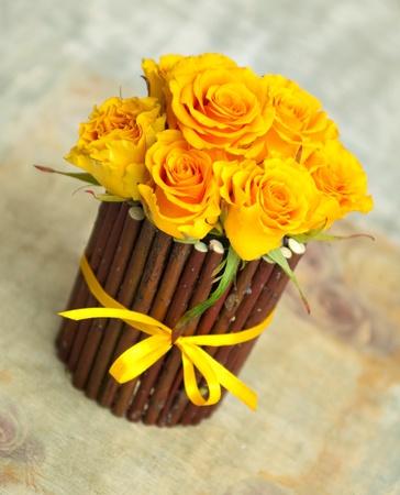 Beautiful small yellow roses in decorative flowerpot