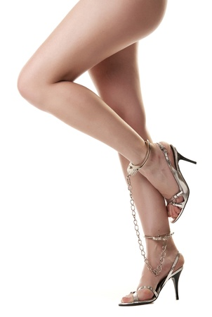A pair of long handcuffed female legs isolated on white background