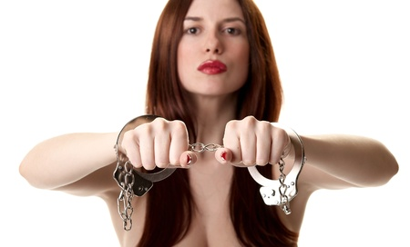 Young sexy brunette in handcuffs isolated on white background Stock Photo - 9532814