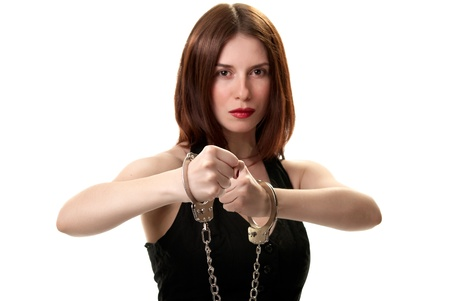Young sexy brunette in handcuffs isolated on white background Stock Photo - 9532807