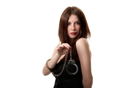 Young sexy brunette in handcuffs isolated on white background Stock Photo - 9532811