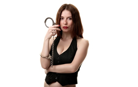 Young sexy brunette in handcuffs isolated on white background Stock Photo - 9532805