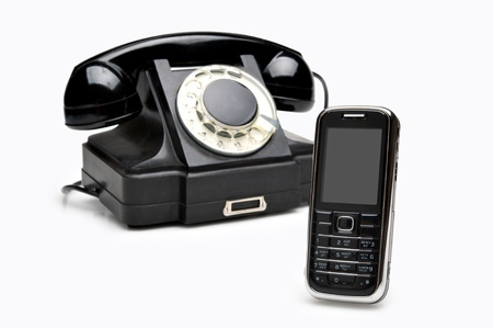 Retro classics and modern cellular phones isolated over white background photo