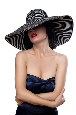 Elegant female portrait wearing wide brim hat over eyes isolated on white