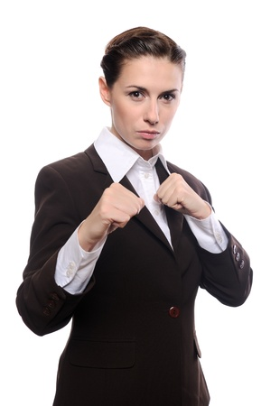 Portrait of an attractive young businesswoman punching. Isolated on white background photo