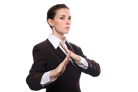 Karate business woman in defence pose isolating on white background photo