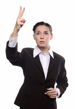 Young business woman showing bidding gesture over white background