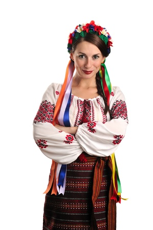 Portrait of joyful young Ukrainian woman in national costume. Isolated on white background Stock Photo - 11298787
