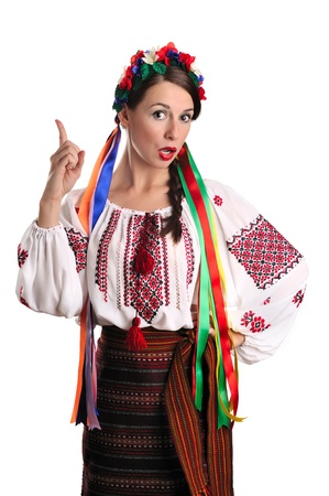 Portrait of joyful young Ukrainian woman in national costume. Isolated on white background photo