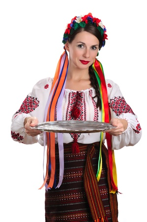 Young Ukrainian woman in national costume holding epmty tray. Isolated on white background photo