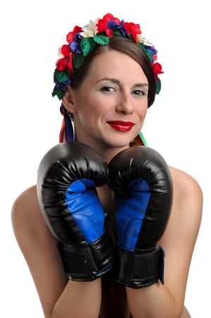 Girl with boxing gloves and floral wreath on her head. Isolated on white background photo